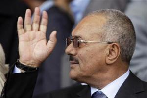 Yemen's President Ali Abdullah Saleh waves to pro-government supporters during a rally in Sanaa