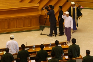 Myanmar's President Thein Sein waves to members of parliament after delivering his speech in Naypyitaw