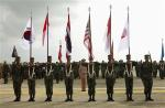 "File photo of Thai soldiers carrying national flags as they participate in the opening ceremony of the annual joint ""Cobra Gold 2010"" (CG10) military exercise at U-tapao airport in Rayong province"