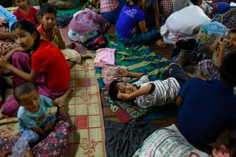 Muslims rest in a temporary refugee camp at Htan Kone village, in Myanmar's northern Sagaing region