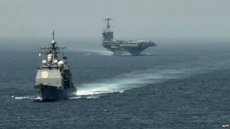 """A picture released by the U.S. Navy shows the guided-missile cruiser """"USS Gettysburg"""" (left) and the aircraft carrier """"USS Harry S. Truman"""" transiting the Strait of Gibraltar earlier this month on their way to the Mediterranean Sea."""
