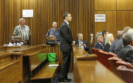 Pistorius stands in the dock with a sick-bucket on the bench behind him (Kim Ludbrook/AFP/Getty Images)