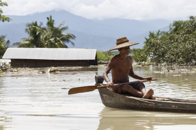 Better than a roof or even a raft: a boat. Soe Zeya Tun/Reuters A flooded street in Kalay, in Northwest Myanmar's Sagaing Div